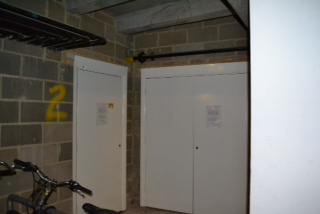 down the ramp to the right are located the gas and electricity meters